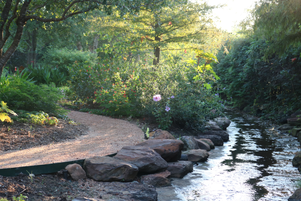 Decomposed Granite Path and Stone Boulders Next to Waterway